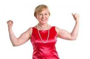 13209997 - portrait of fit senior woman flexing her biceps