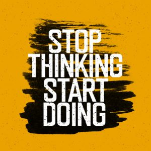 """47266965 - motivational poster with lettering """"stop thinking start doing"""". on yellow paper texture."""